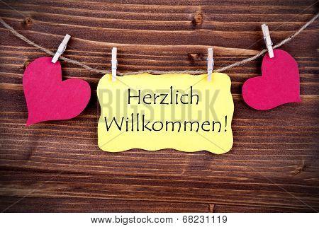 Yellow Label With Herzlich Willkommen