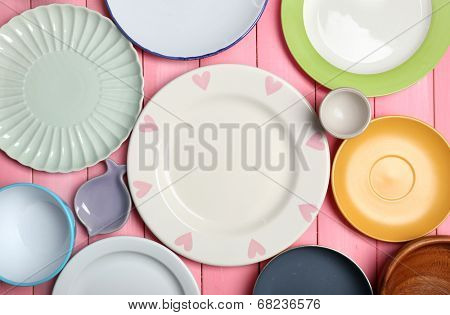 Different tableware on wooden background