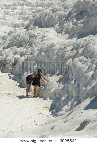 White Limestone Of Pamukkale With Tourists Against
