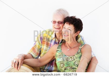 Mature couple smiling and embracing