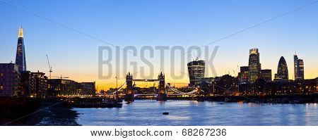 A panoramic view of the beautiful London skyline at dusk. The view takes in sights including the Shard Tower Bridge St Paul's Cathedral 20 Fenchurch Street (Walkie Talkie Building) 122 Leadenhall Street (The Cheesegrater) The Gherkin and Heron Tower. poster