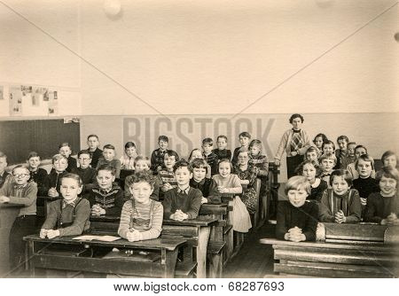 GERMANY, CIRCA 1953 - Vintage photo of group of schoolmates in their classroom