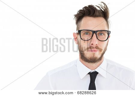 Geeky young businessman looking at camera on white background