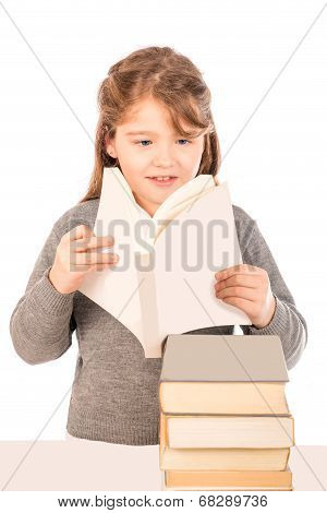 Little Girl Wearing A School Uniform Reading A Book