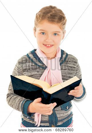 Little Girl Holding A Big Book And Smiling