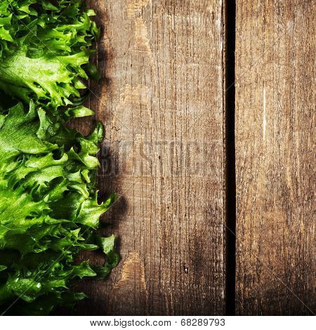Salad On Wooden Background.