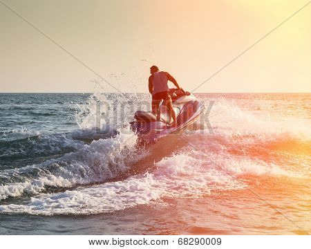 Silhouette Of Man On Jetski At Sea