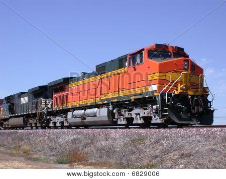 Orange locomotive freight train