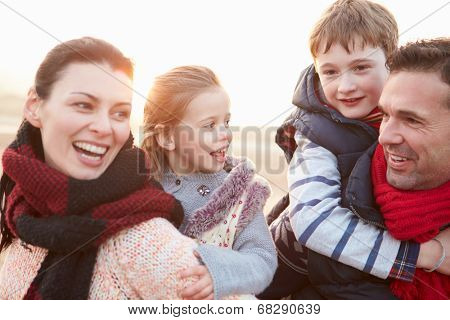 Portrait Of Family On Winter Beach