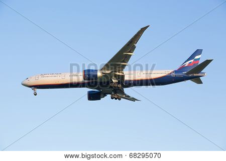 The plane Boing-777-300ER of airline Aeroflot decreases before landing at the Sheremetyevo airport