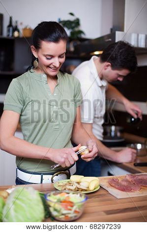 Young Couple Preparing Lunch