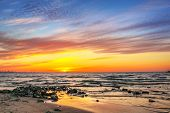 Sunset on the beach at Baltic Sea in Poland poster