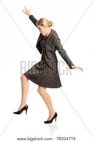 Beautiful woman walking extremelly carefully