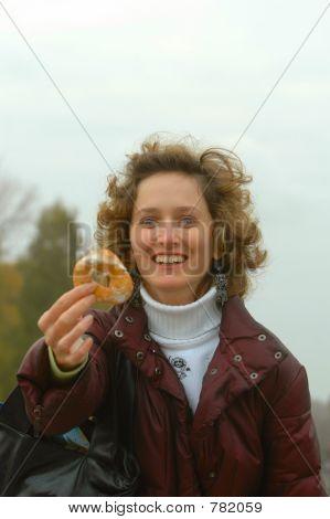 Lady eating donut