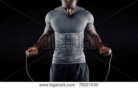 Muscular Man Skipping Rope