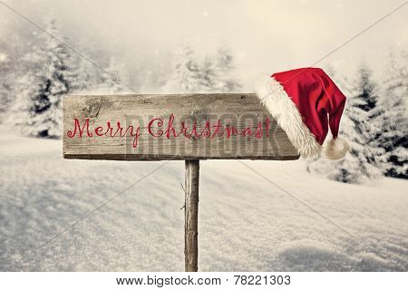 Wooden signboard in snowy winter landscape poster