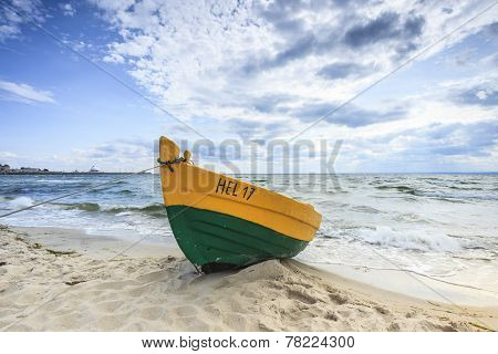 Wooden boat on The Baltic shore Hel Peninsula. poster