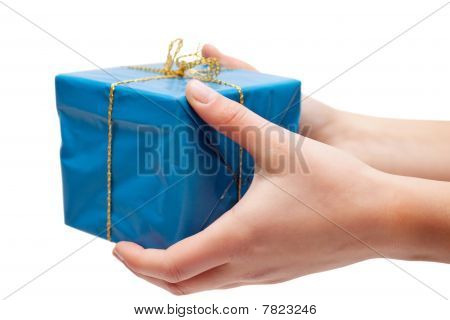 Woman Hand Holding A Gift Box Against White