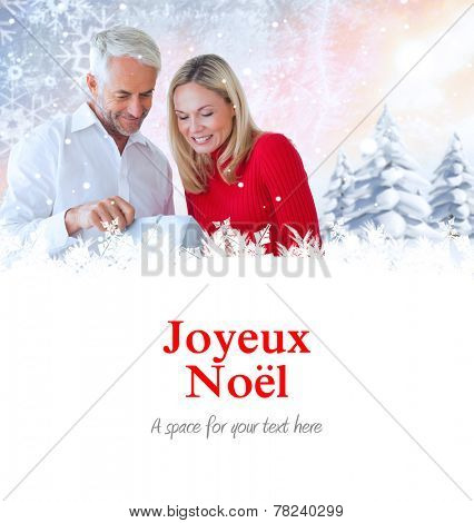 loving couple with shopping bag against joyeux noel