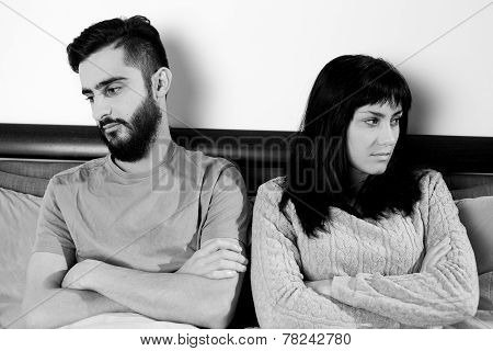 Angry Couple In Bed Not Talking To Each Other