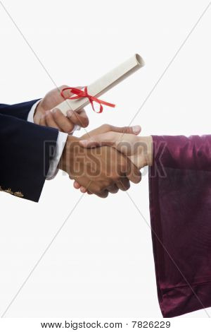 handshake and diploma