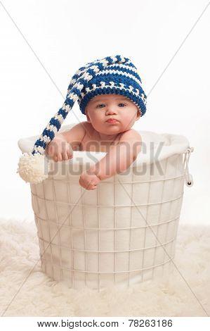 Pouting Baby Boy Wearing A Stocking Cap