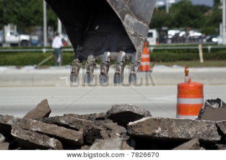 Excavator Bucket above Debris