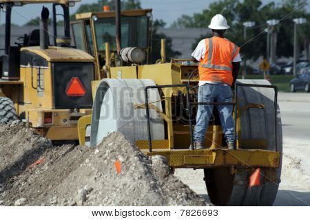 Worker Operating a Compactor (1)