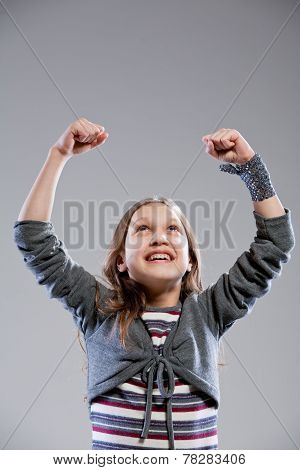 Little Girl Exulting Raising Her Arms