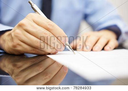 businessman is writing a letter or signing a agreement poster