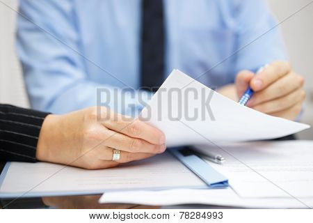 Business People At The Office Discussing And Analyzing Document