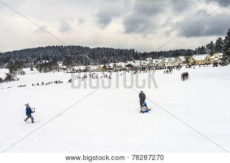 Families Enjoy The Snow In Koenigstein