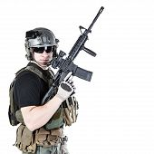 Studio shot of private military contractor PMC with assault rifle poster