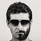 split personality - black and white portrait of man with half shaved face and sun glasses poster