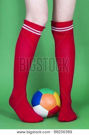 Red socks long legs and football
