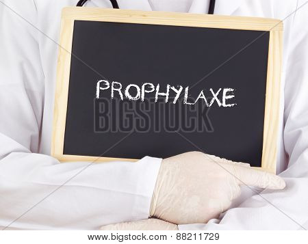 Doctor Shows Information On Blackboard: Prophylaxis In German