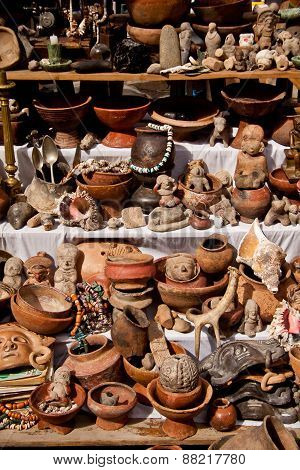 Stall with indigenous pottery figures in the popular Otavalo market, Ecuador