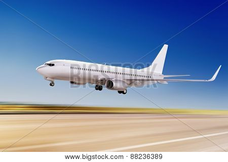 white passenger plane is flying up from airport