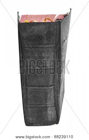 a worn-out old book with a black cover on a white background