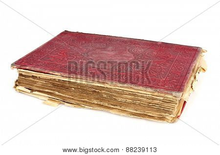 a worn-out old book with a red cover on a white background