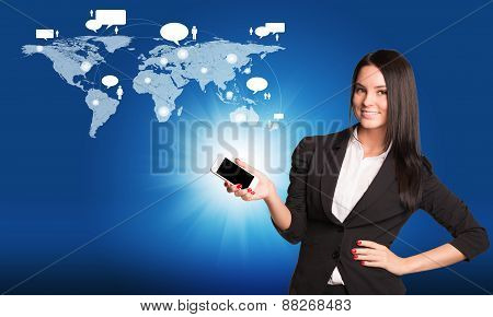 Beautiful businesswoman standing and holding mobile phone