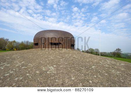 Belgian bunker from WW II under a blue cloudy sky