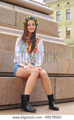 Pretty Ukrainian Girl Sits On Monument