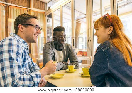 Multiracial Group Of Friend In A Coffee Bar