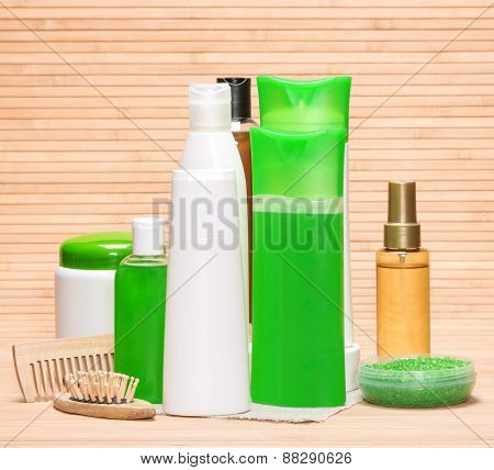 Set of cosmetics and accessories for the daily care of hair health and beauty: shampoo conditioner balm mask oil wooden combs sea salt poster