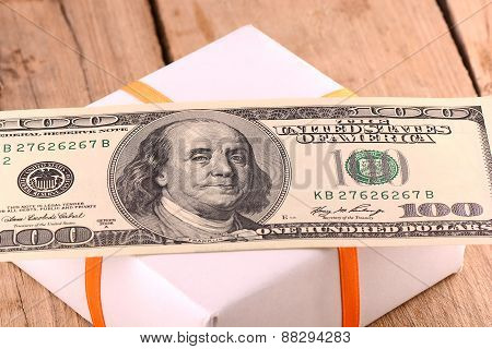 Holiday Bonus.  American Money On Green Gift Box