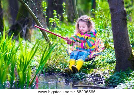 Little Girl Fishing In A Forest