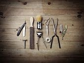 Set of vintage barber tools on wood desk poster