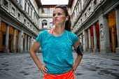 Portrait of fitness woman near uffizi gallery in florence italy poster