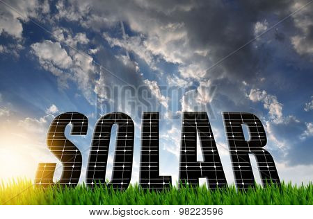 The word Solar from solar energy panels against sunset sky